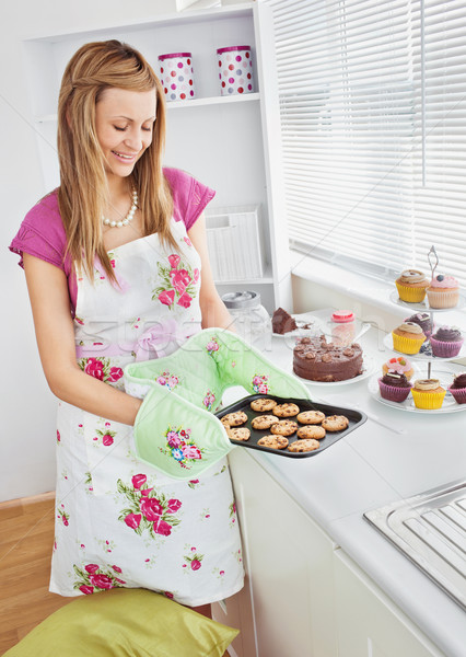 Cute young woman baking cookies in the kitchen at home Stock photo © wavebreak_media