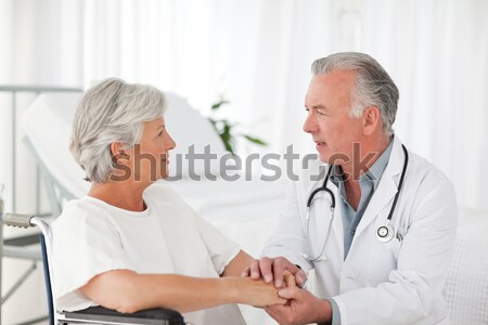Senior doctor taking the blood pressure of his patient Stock photo © wavebreak_media