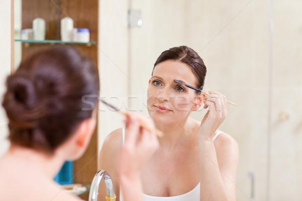 Donna ciglia mano sorriso occhi donne Foto d'archivio © wavebreak_media