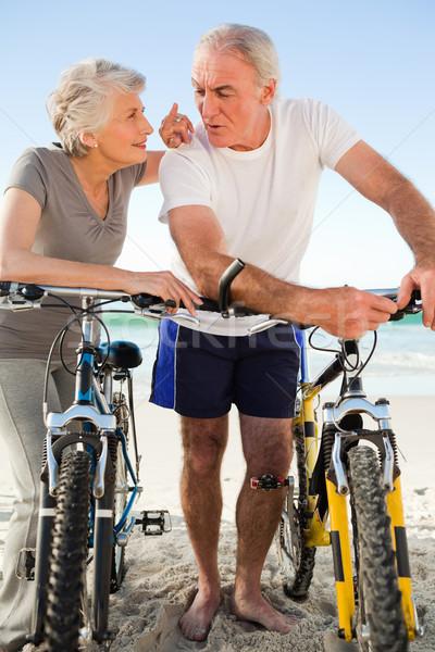 Aposentados casal bicicletas praia mar saúde Foto stock © wavebreak_media