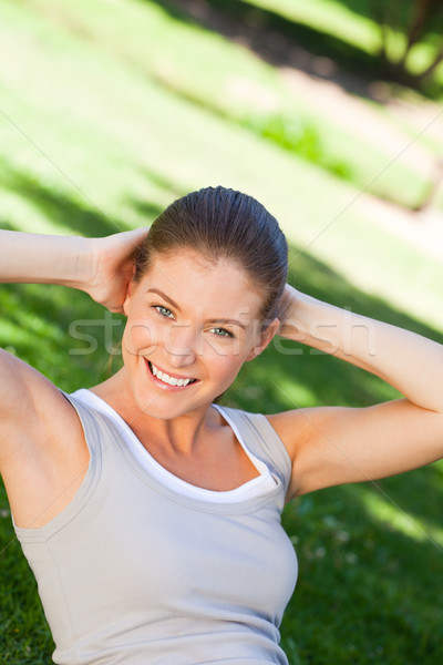 Woman doing her stretches in the park Stock photo © wavebreak_media
