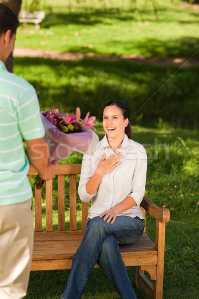 Genç teklif çiçekler eş kadın yaz Stok fotoğraf © wavebreak_media