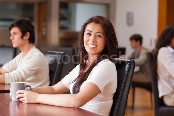 Joyful woman having a cup of tea in a cafe Stock photo © wavebreak_media
