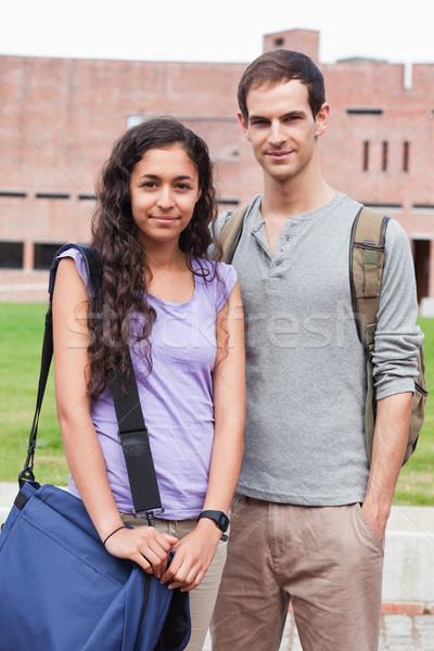 Portrait of a student couple posing outside a building Stock photo © wavebreak_media