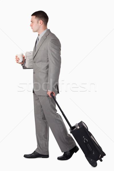 Businessman on the go against a white background Stock photo © wavebreak_media