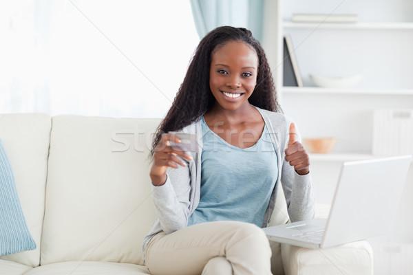 笑顔の女性 幸せ オンラインショッピング コンピュータ インターネット ホーム ストックフォト © wavebreak_media