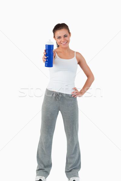 Mujer sonriente ofrecimiento sorbo agua blanco salud Foto stock © wavebreak_media