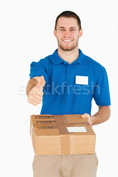Uśmiechnięty młodych sprzedawca kciuk w górę Zdjęcia stock © wavebreak_media