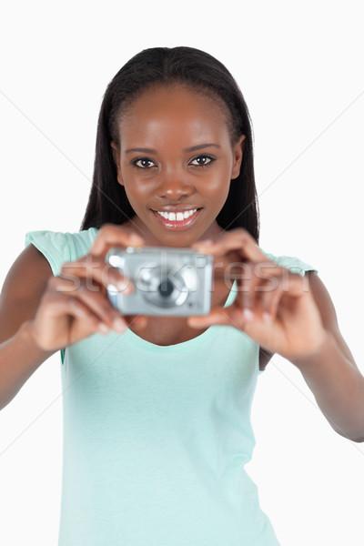 улыбаясь цифровая камера белый девушки фон Сток-фото © wavebreak_media