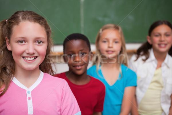 Osztálytársak pózol csetepaté osztályterem diák oktatás Stock fotó © wavebreak_media