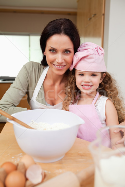 Mother and daughter preparing cake together Stock photo © wavebreak_media