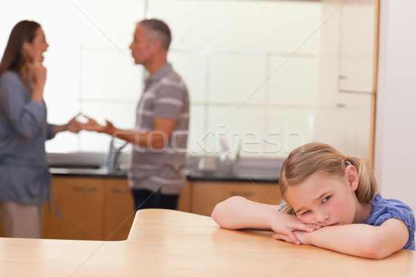 Sad girl hearing her parents fitting in a kitchen Stock photo © wavebreak_media