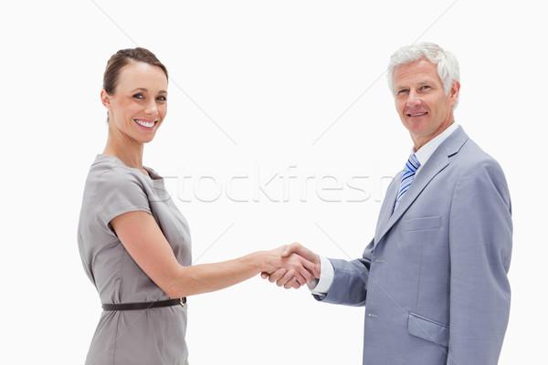 Beyaz saçlı adam el sıkışmak kadın Stok fotoğraf © wavebreak_media