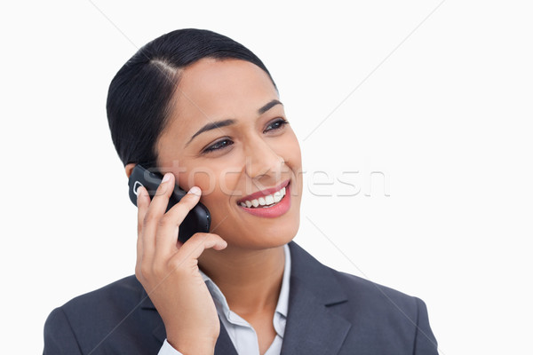 Close up of smiling saleswoman on her cellphone against a white background Stock photo © wavebreak_media