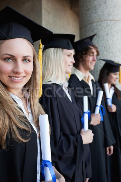 Portrait diplômé yeux bleus amis posant Photo stock © wavebreak_media