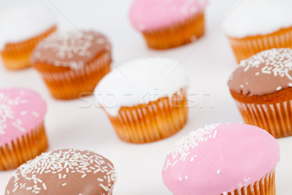 Blurred muffins with icing sugar against a white background Stock photo © wavebreak_media
