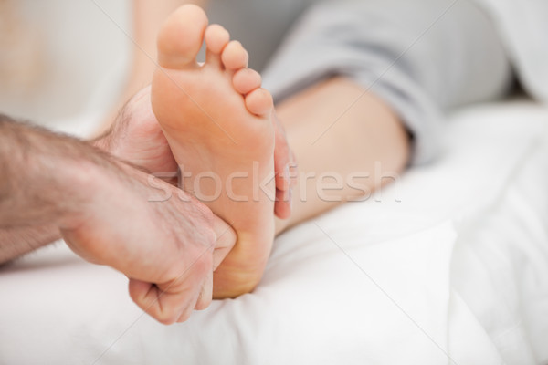 Ball of a foot being touched by a doctor in a room Stock photo © wavebreak_media