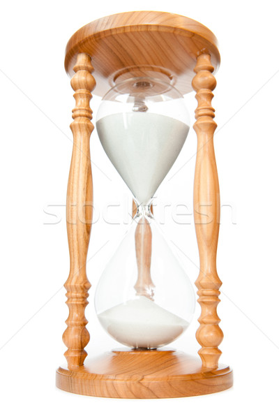 Sand flowed of hourglass against a white background Stock photo © wavebreak_media