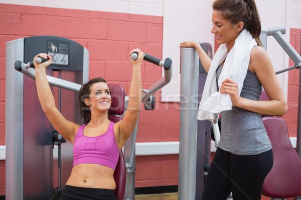 女性 重量 マシン 笑みを浮かべて 友達 ジム ストックフォト © wavebreak_media