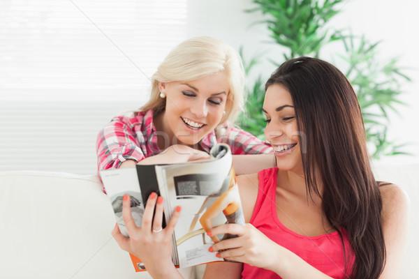 Kadın bakıyor katalog ev gülen yüz Stok fotoğraf © wavebreak_media
