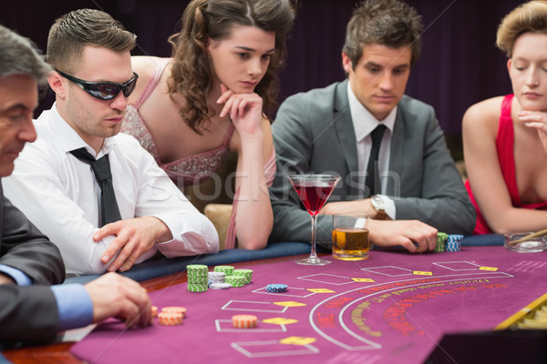 People around the poker table in casio Stock photo © wavebreak_media