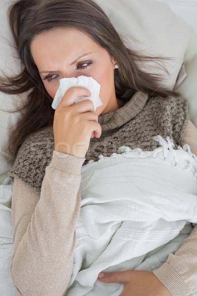 Enfermos mujer nariz sofá Foto stock © wavebreak_media