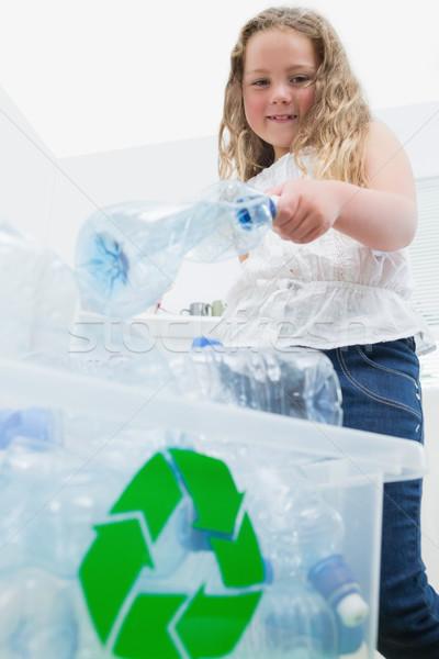 Bambina bottiglie riciclaggio finestra felice Foto d'archivio © wavebreak_media
