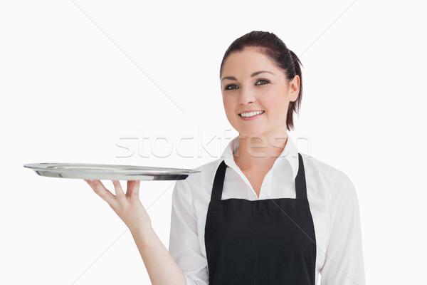 Stock photo: Waitress in apron holding empty silver tray