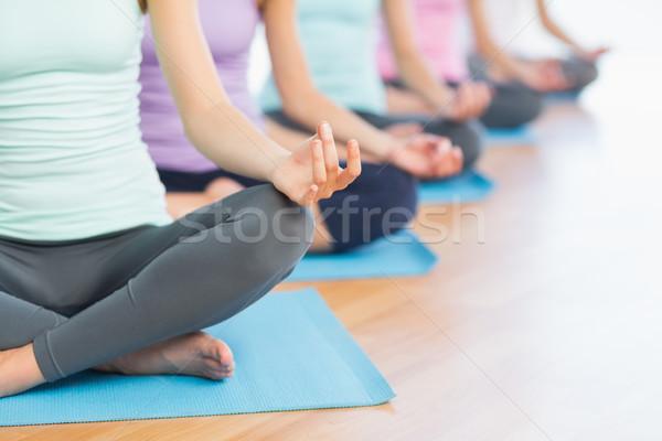 Sportos nők lótusz póz fitnessz stúdió Stock fotó © wavebreak_media