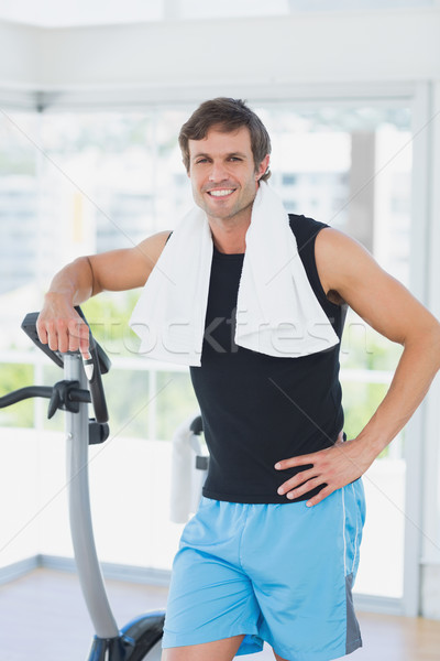 Portrait of a smiling man at spinning class in bright gym Stock photo © wavebreak_media