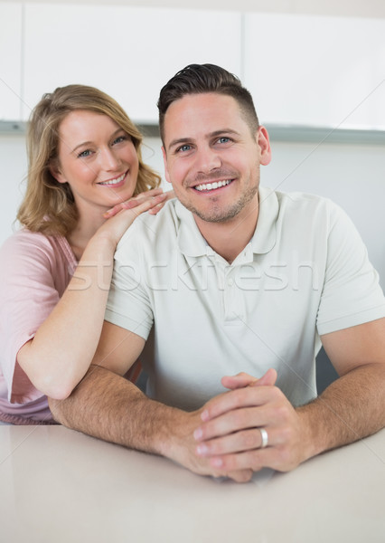 Smiling young couple at kitchen counter Stock photo © wavebreak_media