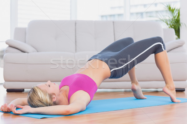 Slim blonde lifting her pelvis on exercise mat Stock photo © wavebreak_media