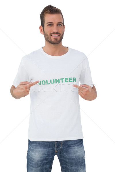 Retrato feliz masculina voluntario senalando ayudar Foto stock © wavebreak_media