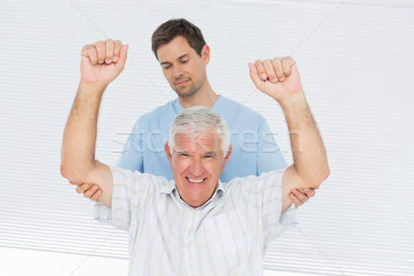 Senior man handen mannelijke medische kantoor Stockfoto © wavebreak_media