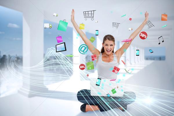 Usando laptop aplicativo ícones composição digital Foto stock © wavebreak_media
