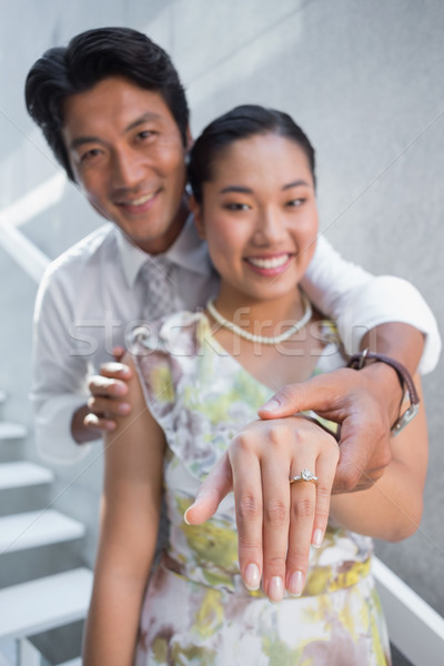 Stock photo: Couple showing engagement ring on womans finger