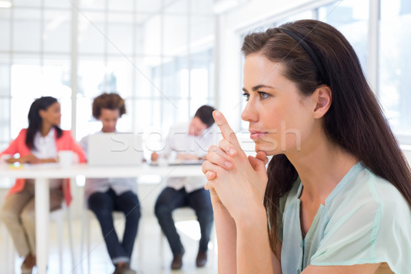 Attractive businesswoman concentrating and focusing Stock photo © wavebreak_media