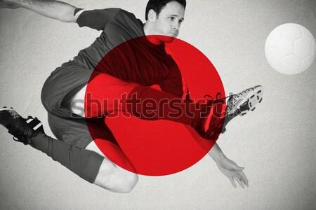 Goalkeeper in red jumping up Stock photo © wavebreak_media