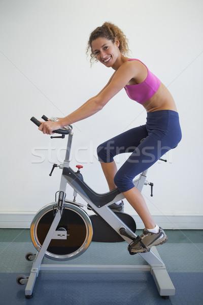 соответствовать женщину спин велосипедов улыбаясь камеры Сток-фото © wavebreak_media