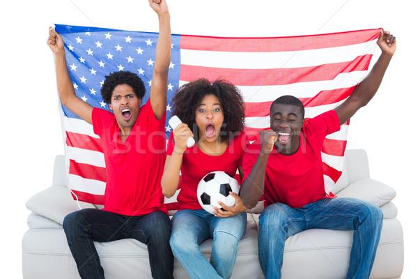 Foto stock: Futebol · fãs · vermelho · sessão · sofá