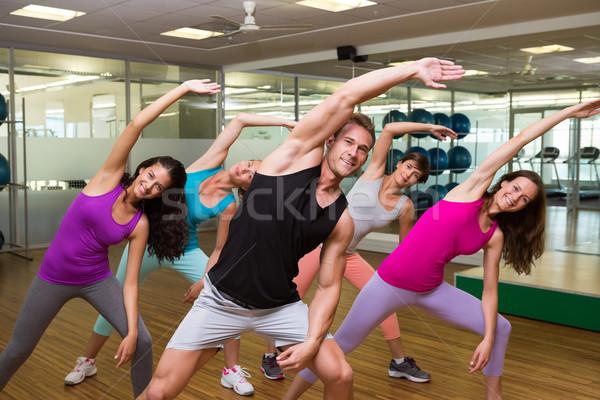Fitnessz osztály jóképű oktató tornaterem férfi Stock fotó © wavebreak_media