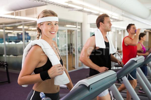 Row of people working out on treadmills Stock photo © wavebreak_media