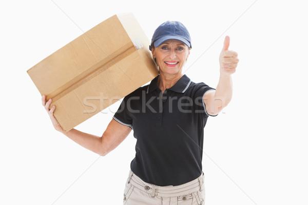 Happy delivery woman holding cardboard box Stock photo © wavebreak_media