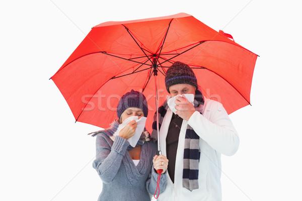 Mature couple blowing their noses under umbrella Stock photo © wavebreak_media