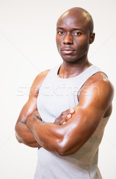 Portrait of a serious muscular man with arms crossed Stock photo © wavebreak_media