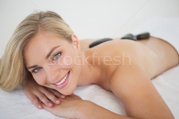 Beautiful blonde enjoying a hot stone massage  Stock photo © wavebreak_media