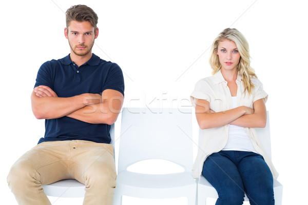 Young couple sitting in chairs not talking during argument Stock photo © wavebreak_media