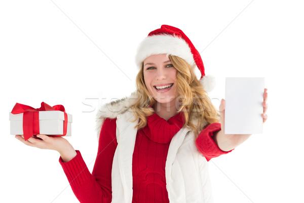 Festive blonde holding gift on right hand Stock photo © wavebreak_media