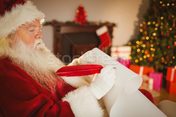 Santa claus writing his list on scroll Stock photo © wavebreak_media