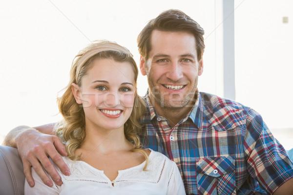 Loving couple looking at the camera Stock photo © wavebreak_media